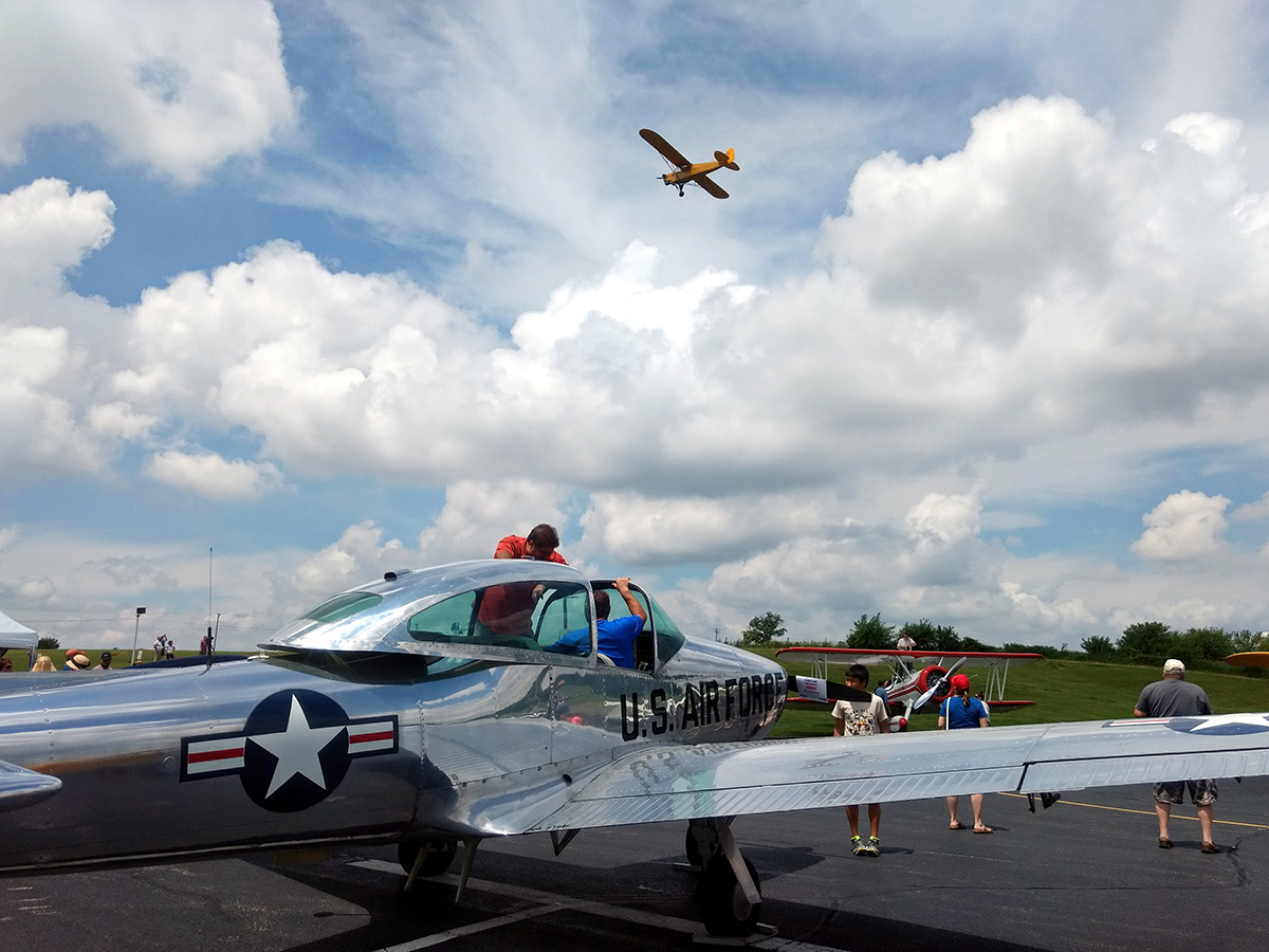 USAF plane w cub passing - Barnstormers Day 2017 - EAA 932