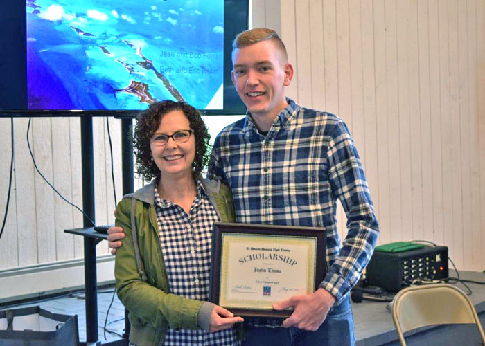 Beth Rehm presents scholarship award to Justin Thuma.