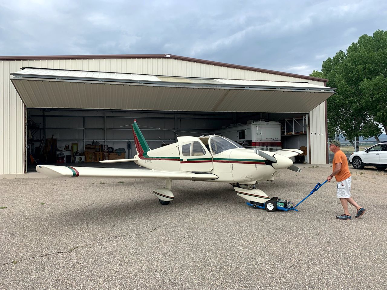 Larry Putting Lucy In Hangar recreational aerobatics
